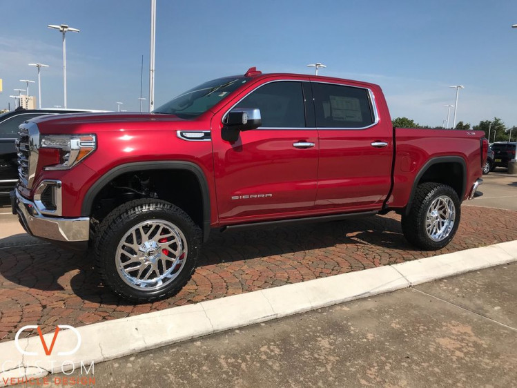 """2020 GMC Sierra with 22"""" Chrome Plated Fuel Triton wheels and Custom Painted Red Calipers"""