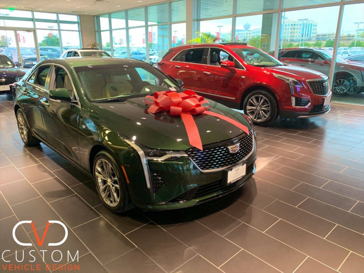 Green Cadillac CT4 and Red CT5 both on Vogue VT375 wheels