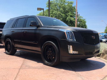 Matte Black Cadillac Escalade with black PID grille