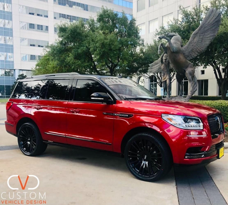 """Red Two Tone Lincoln Navigator with 24"""" Kruger wheels"""