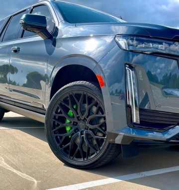 """2021 Cadillac Escalade with 24"""" Vossen wheels wrapped in Vogue Tyres"""