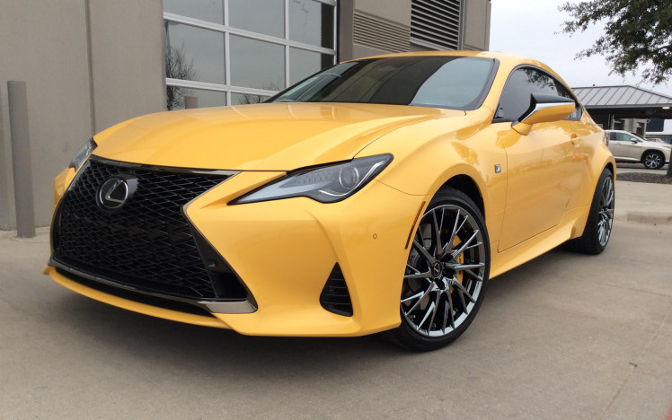 Lexus RC300 with factory black chrome RC F wheels and factory matched flare yellow calipers