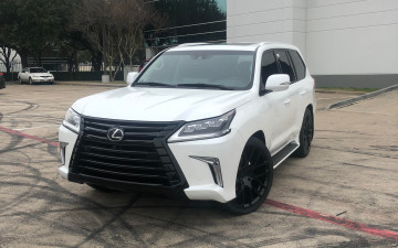 "Lexus LX570 body color trim and black out with 24"" Black Rhino Kunene with 285/35/24 Toyo's"