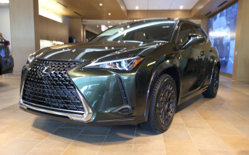 "Lexus UX200 green urban lander with contrasting painted fender flare moldings with 17"" boxer wheel wrapped in 215/60/17 Yokohama Geolander tires"