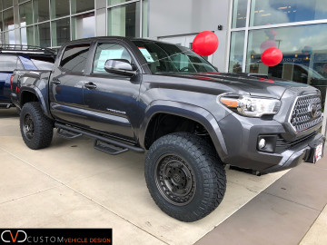 Toyota Tacoma With 18 inch Black Rhino Armory wheels (gunblack) and dealer installled lift and 275/70/18 Nitto Ridge Grappler Tires
