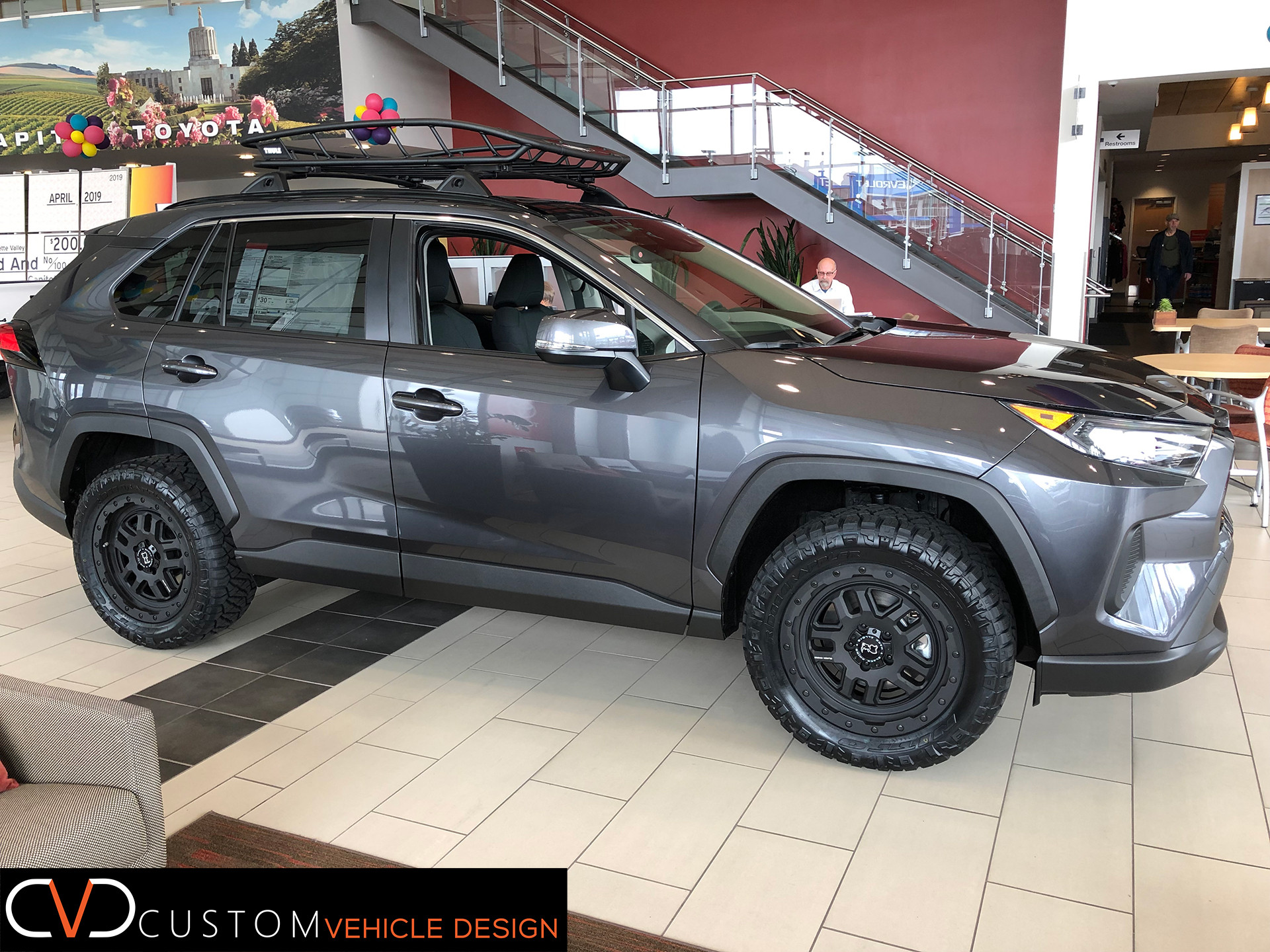 Toyota RAV4 With 18 inch Black Rhino Barstow wheels and dealer installed 255/55/18 Nitto Ridge Grappler tires