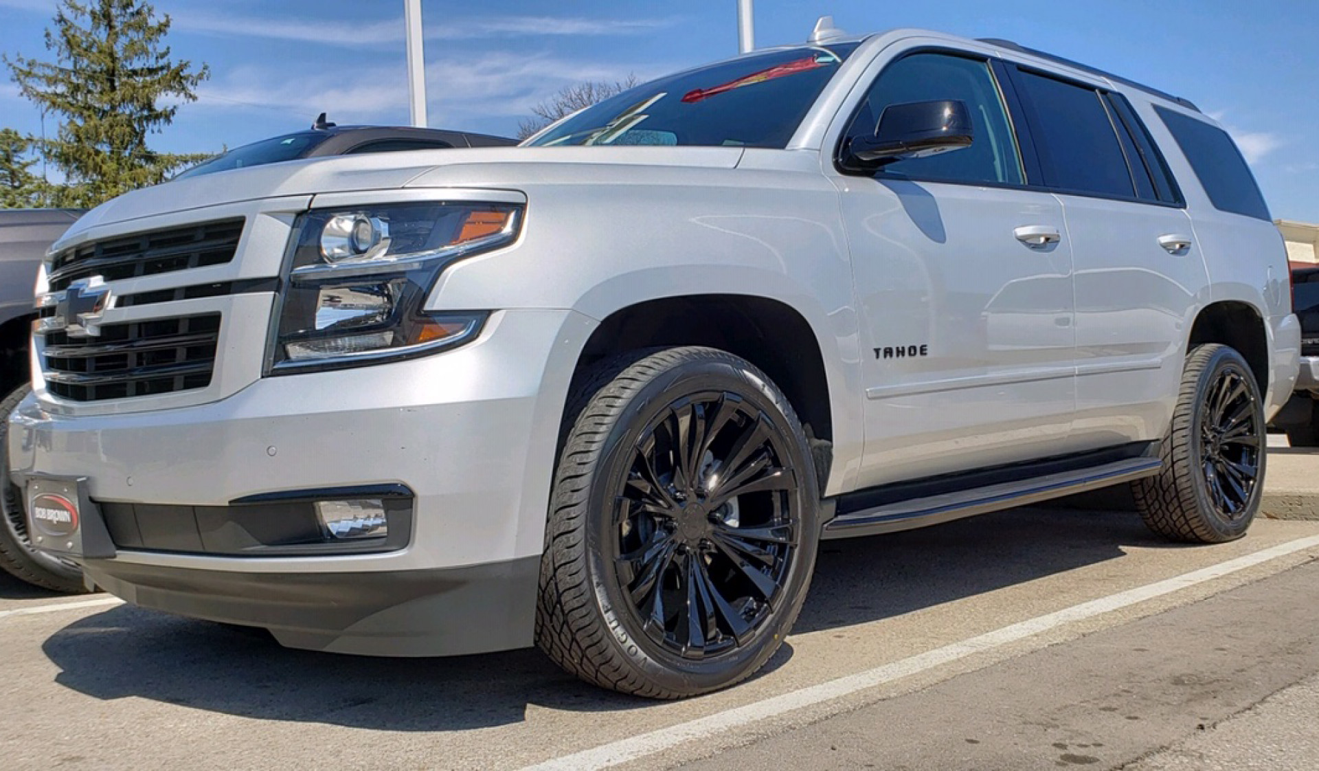 2018 Chevy Tahoe, gloss black Rampage wheels and Sig V's