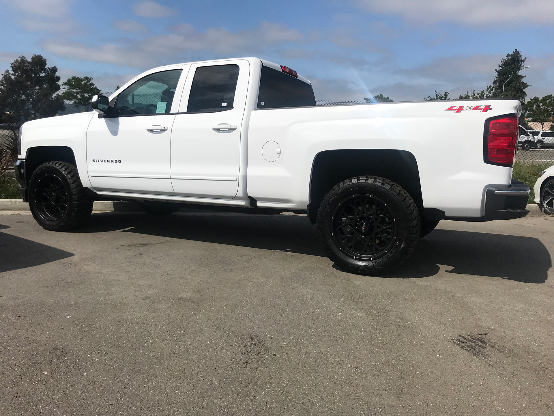 "Chevrolet Silverado 20"" Vision 412 Rocker wrapped in 3312.50R20 off-road tires"