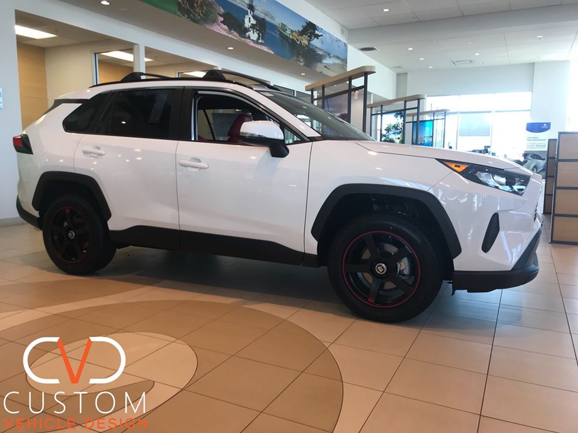 "Toyota RAV4 with 17"" Motegi MR-116 wheels to match the custom red leather"