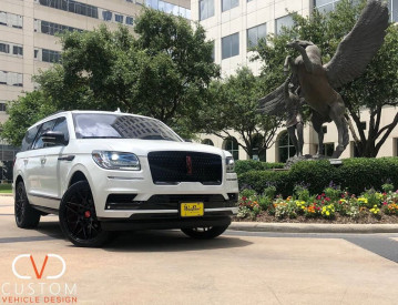 """2020 Lincoln Navigator - Deviate Signature series - with 24"""" Griffin Gloss Black wheels."""