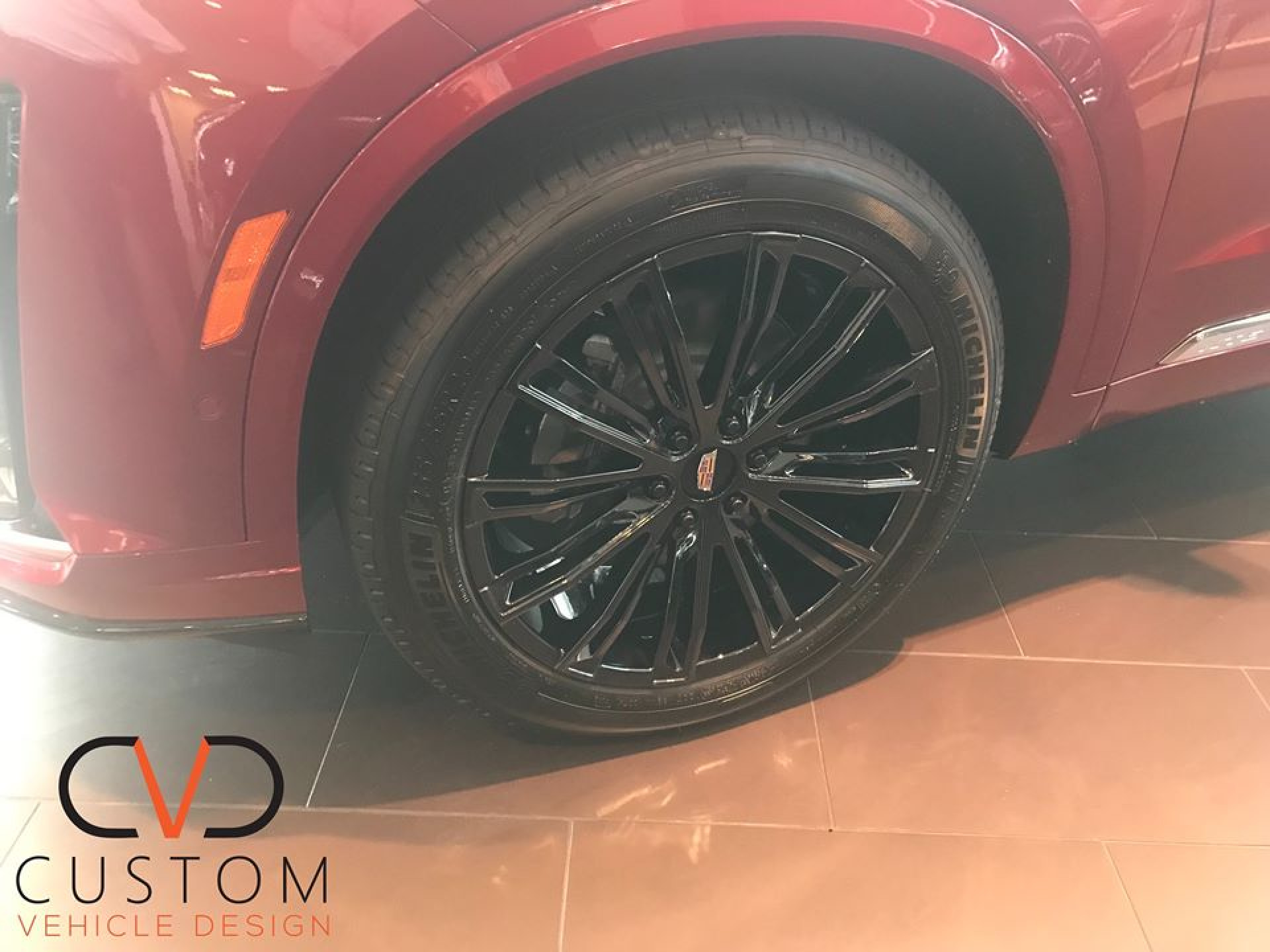 Black Vogue VT386 wheels on a Cadillac XT6