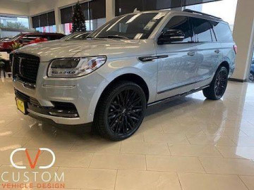 """2020 Lincoln Navigator with 24"""" Status Adamus wheels and 305/35-24 Vogue Signature V tires"""